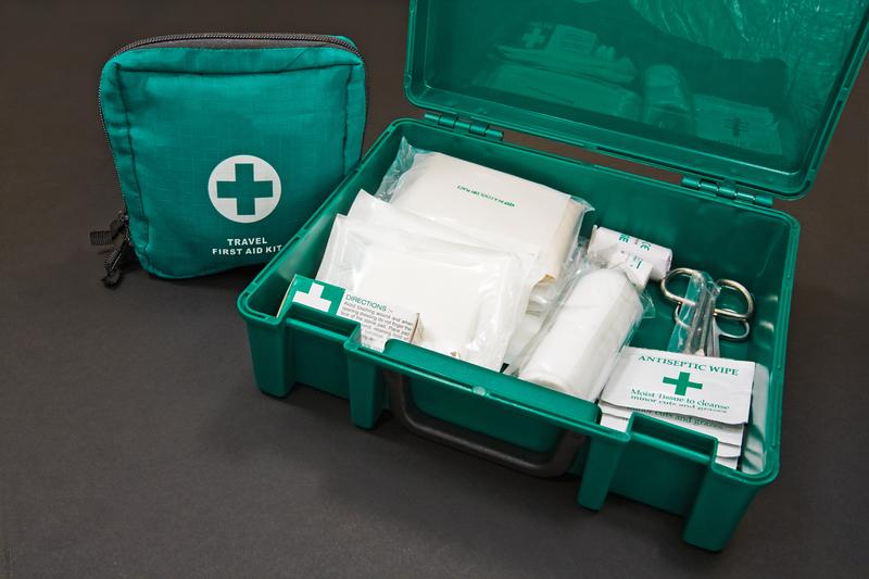 A green standard First aid kit